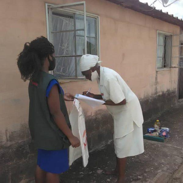Diapora Insurance donating food to widows