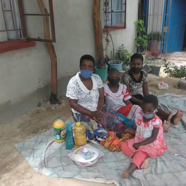 Diapora Insurance donating food to widows4